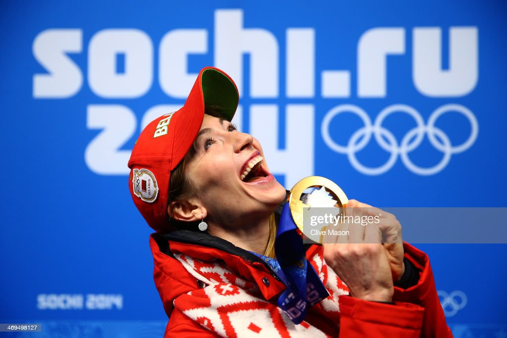 Gold medalist <a gi-track='captionPersonalityLinkClicked' href=/galleries/search?phrase=Darya+Domracheva&family=editorial&specificpeople=4105955 ng-click='$event.stopPropagation()'>Darya Domracheva</a> of Belarus celebrates during the medal ceremony for the Biathlon Women's 15km Individual on day 8 of the Sochi 2014 Winter Olympics at Medals Plaza on February 15, 2014 in Sochi, Russia.