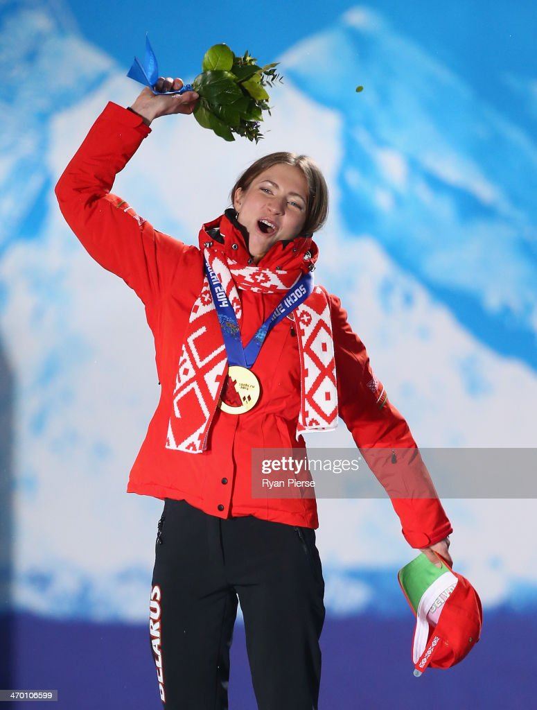 Gold medalist <a gi-track='captionPersonalityLinkClicked' href=/galleries/search?phrase=Darya+Domracheva&family=editorial&specificpeople=4105955 ng-click='$event.stopPropagation()'>Darya Domracheva</a> of Belarus celebrates on the podium during the medal ceremony for the Women's 12.5 km Mass Start on day 11 of the Sochi 2014 Winter Olympics at Medals Plaza on February 18, 2014 in Sochi, Russia.