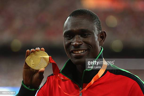 Gold medalist David Lekuta Rudisha of Kenya poses on the podium during the medal ceremony for the Men's 800 metres during day five of the 15th IAAF...