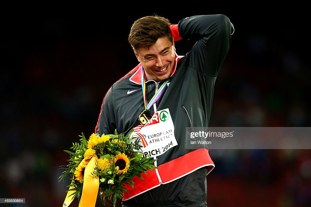 Gold medalist <a gi-track='captionPersonalityLinkClicked' href=/galleries/search?phrase=David+Storl&family=editorial&specificpeople=4399215 ng-click='$event.stopPropagation()'>David Storl</a> of Germany celebrates on the podium during the medal ceremony for the Men's Shot Put final during day one of the 22nd European Athletics Championships at Stadium Letzigrund on August 12, 2014 in Zurich, Switzerland.