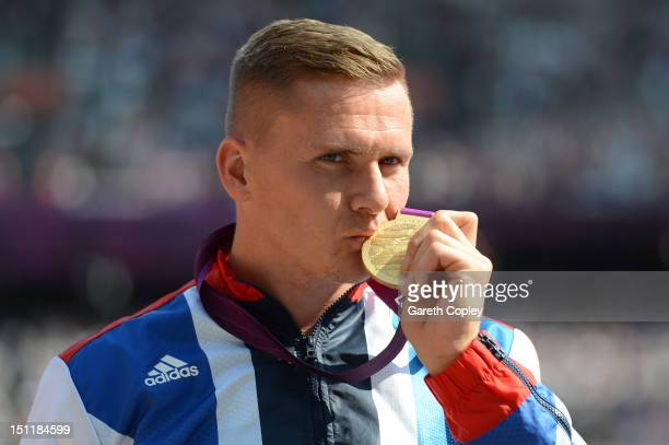 Gold medalist David Weir of Great Britain Poses on the podium during the medal ceremony for the Men's 5000m T54on day 5 of the London 2012 Paralympic...