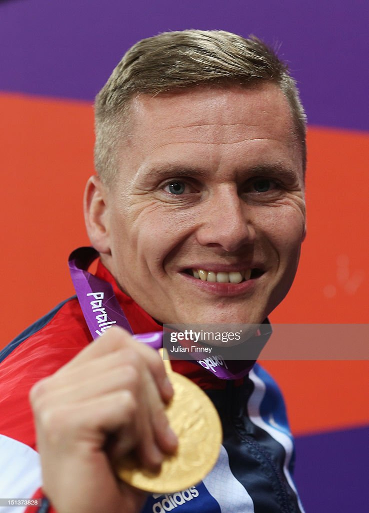 Gold medalist David Weir of Great Britain poses on the podiumduring the medal ceremony for Men's 800m - T54 Final on day 8 of the London 2012 Paralympic Games at Olympic Stadium on September 6, 2012 in London, England.