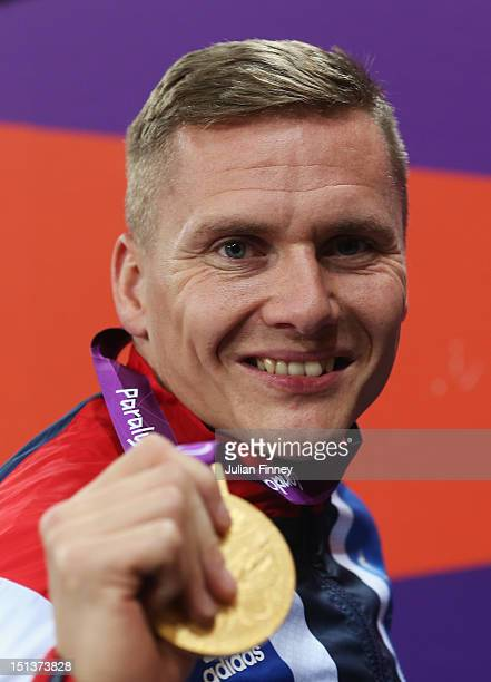 Gold medalist David Weir of Great Britain poses on the podiumduring the medal ceremony for Men's 800m T54 Final on day 8 of the London 2012...