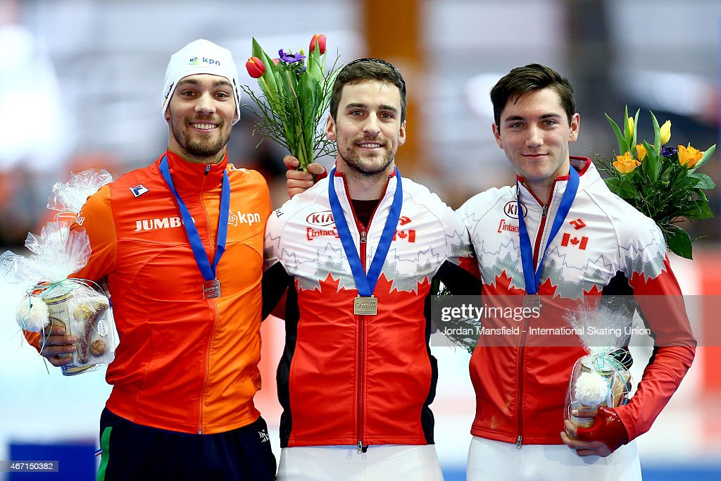 Gold medalist <a gi-track='captionPersonalityLinkClicked' href=/galleries/search?phrase=Denny+Morrison&family=editorial&specificpeople=726041 ng-click='$event.stopPropagation()'>Denny Morrison</a> of Canada (C), Silver medalist <a gi-track='captionPersonalityLinkClicked' href=/galleries/search?phrase=Kjeld+Nuis&family=editorial&specificpeople=7449588 ng-click='$event.stopPropagation()'>Kjeld Nuis</a> of the Netherlands (L) and Bronze medalist Vincent De Haitre of Canada (R) pose for a photo after winning the Men's 1000m on Day 1 of the ISU World Cup Speed Skating Final at the Gunda Niemann-Stirnemann-Halle on March 21, 2015 in Erfurt, Germany.