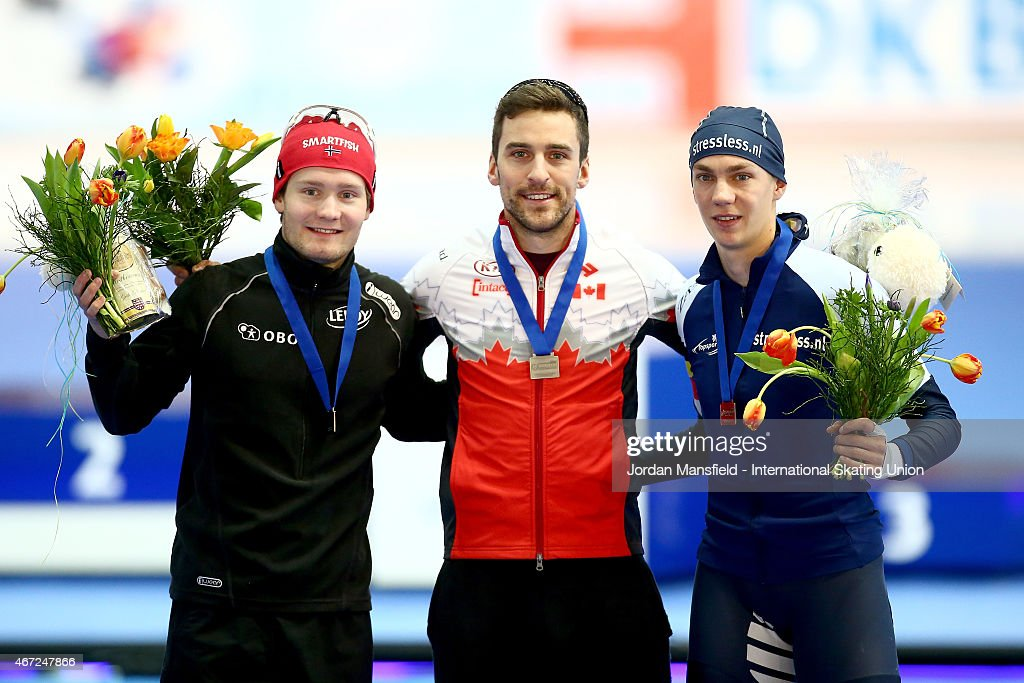 Gold medalist <a gi-track='captionPersonalityLinkClicked' href=/galleries/search?phrase=Denny+Morrison&family=editorial&specificpeople=726041 ng-click='$event.stopPropagation()'>Denny Morrison</a> of Canada (C), Silver medalist <a gi-track='captionPersonalityLinkClicked' href=/galleries/search?phrase=Sverre+Lunde+Pedersen&family=editorial&specificpeople=6523814 ng-click='$event.stopPropagation()'>Sverre Lunde Pedersen</a> of Norway (L) and Bronze medalist <a gi-track='captionPersonalityLinkClicked' href=/galleries/search?phrase=Bart+Swings&family=editorial&specificpeople=7294720 ng-click='$event.stopPropagation()'>Bart Swings</a> pose for a photo after winning the Men's 1500m on Day 2 of the ISU World Cup Speed Skating Final at the Gunda Niemann-Stirnemann-Halle on March 22, 2015 in Erfurt, Germany.