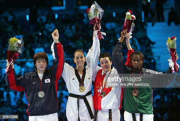 Gold medalist Diana Lopez of the US celebrates flanked by silver medalist Korean Kim SaeRom and bronze medalists Canadian Karine Sergerie and...