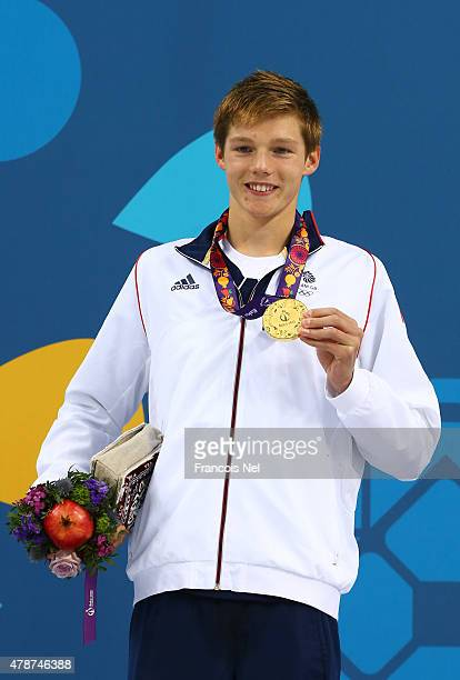 Gold medalist Duncan Scott of Great Britain stands on the podium during the medal ceremony for the Men's 200m Freestyle final during day fifteen of...