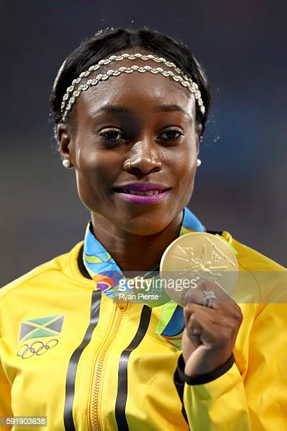 Gold medalist Elaine Thompson of Jamaica poses on the podium during the medal ceremony for the Women's 200m on Day 13 of the Rio 2016 Olympic Games...