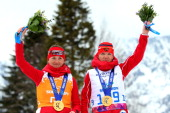 Gold medalist Elena Remizova of Russia and guide Natalia Yakimova pose during the medal ceremony for the Women's Cross Country 5km Free – Visually...