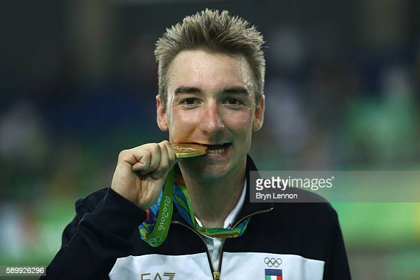 Gold medalist Elia Viviani of Italy celebrates on the podium during the medal ceremony for the Cycling Track Men's Omnium Points Race 66 on Day 10 of...