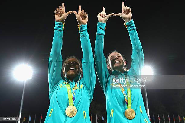 Gold medalist Ellia Green of Australia and her team mate Chloe Dalton pose with her Gold medal after the medal ceremony for the Women's Rugby Sevens...