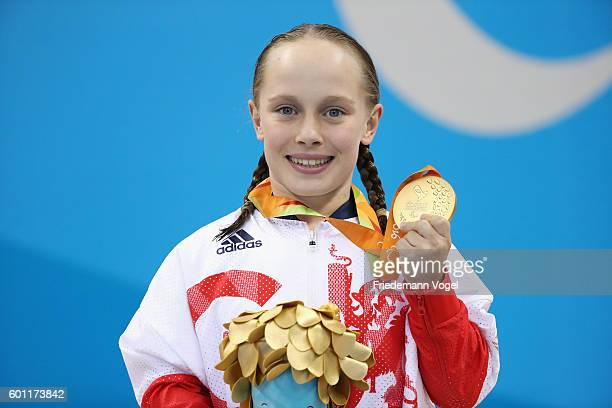 Gold medalist Ellie Robinson of Great Britain celebrates on the podium at the medal ceremony for the Women's 50m Butterfly S6 on day 2 of the Rio...