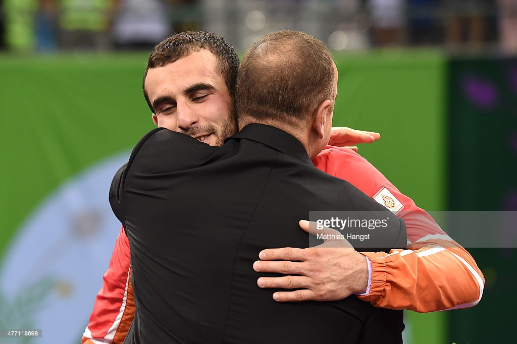 Gold Medalist <a gi-track='captionPersonalityLinkClicked' href=/galleries/search?phrase=Elvin+Mursaliyev&family=editorial&specificpeople=14695881 ng-click='$event.stopPropagation()'>Elvin Mursaliyev</a> of Azerbaijan embraces the President of Azerbaijan <a gi-track='captionPersonalityLinkClicked' href=/galleries/search?phrase=Ilham+Aliyev&family=editorial&specificpeople=565601 ng-click='$event.stopPropagation()'>Ilham Aliyev</a> prior to receiving his medal won in the Men's Wrestling 75kg Greco Roman finals during day two of the Baku 2015 European Games at Heydar Aliyev Arena on June 14, 2015 in Baku, Azerbaijan.