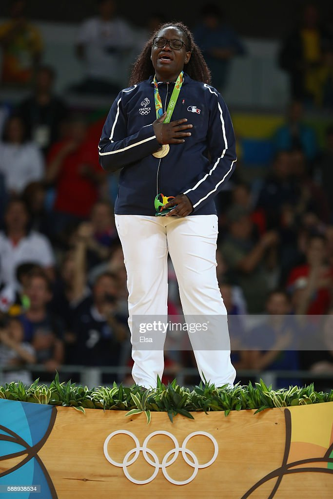 Gold medalist Emilie Andeol of France celebrates on the podium after defeating Idalys Ortiz of Cuba during the Women's 78kg Judo Gold Medal contest...