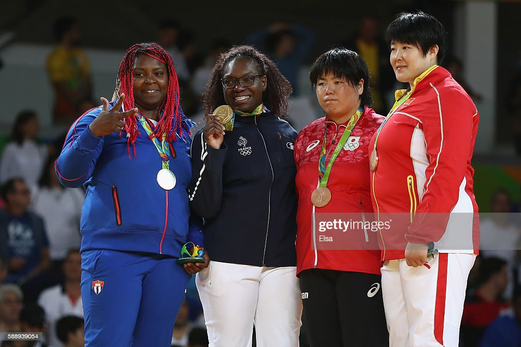 Gold medalist Emilie Andeol of France silver medalist Idalys Ortiz of Cuba bronze medalists Kanae Yamabe of Japan and Song Yu of China celebrate...