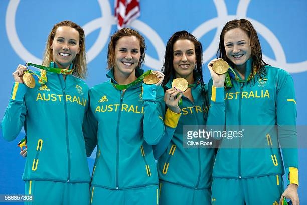 Gold medalist Emma McKeon Brittany Elmslie Bronte Campbell and Cate Campbell of Australia pose during the medal ceremony for the Final of the Women's...