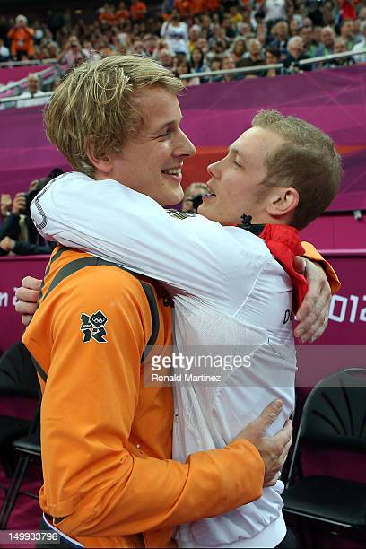 Gold medalist Epke Zonderland of Netherlands and silver medalist Fabian Hambuchen of Germany celebrate after the Artistic Gymnastics Men's Horizontal...