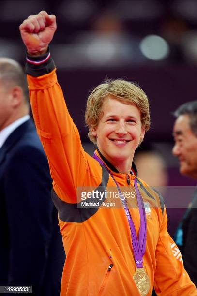 Gold medalist Epke Zonderland of Netherlands poses on the podium after the Artistic Gymnastics Men's Horizontal Bar final on Day 11 of the London...