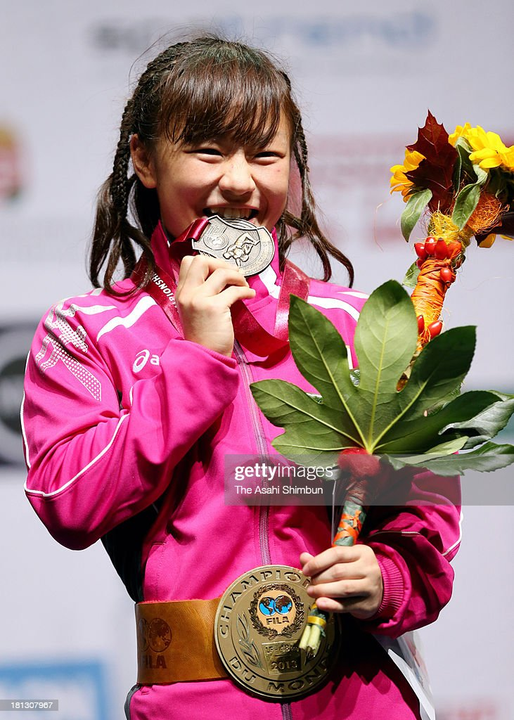 Gold medalist <a gi-track='captionPersonalityLinkClicked' href=/galleries/search?phrase=Eri+Tosaka&family=editorial&specificpeople=9149207 ng-click='$event.stopPropagation()'>Eri Tosaka</a> of Japan poses on the podium after winning in the Women's 48kg Freestyle during day three of the FILA Wrestling World Championships at Papp Laszlo Budapest Sportarena on September 18, 2013 in Budapest, Hungary.