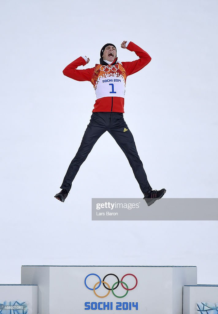 Gold medalist <a gi-track='captionPersonalityLinkClicked' href=/galleries/search?phrase=Eric+Frenzel&family=editorial&specificpeople=4595984 ng-click='$event.stopPropagation()'>Eric Frenzel</a> of Germany jumps in celebration during the flower ceremony for the Men's Nordic Combined Individual Gundersen Normal Hill and 10km Cross Country on day 5 of the Sochi 2014 Winter Olympics at the RusSki Gorki Nordic Combined Skiing Stadium on February 12, 2014 in Sochi, Russia.