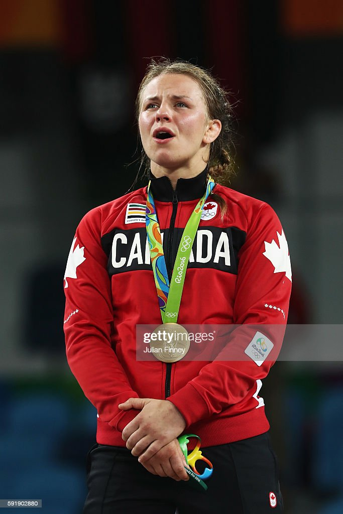 Gold medalist Erica Elizabeth Wiebe of Canada sings along to the national anthem during the medal ceremony following the Women's Freestyle 75 kg competition on Day 13 of the Rio 2016 Olympic Games at Carioca Arena 2 on August 18, 2016 in Rio de Janeiro, Brazil.