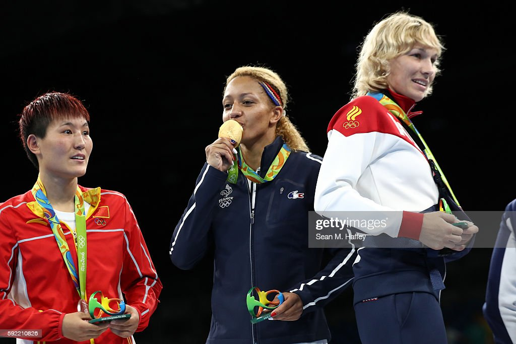 Gold medalist Estelle Mossely of France celebrates on the podium after winning the Women's Light Final Bout Day 14 of the Rio 2016 Olympic Games at the Riocentro arena on August 19, 2016 in Rio de Janeiro, Brazil.