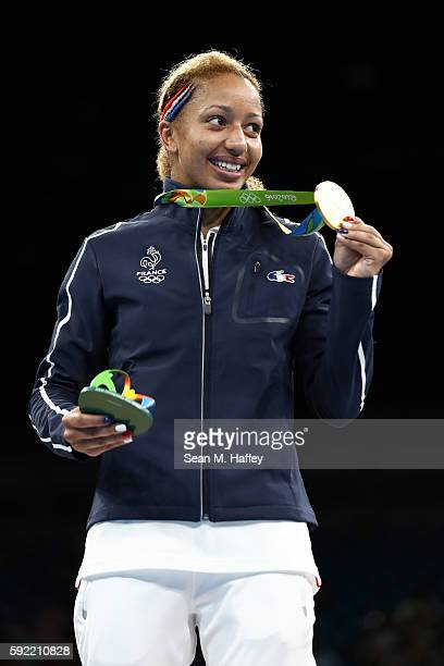 Gold medalist Estelle Mossely of France celebrates on the podium after winning the Women's Light Final Bout Day 14 of the Rio 2016 Olympic Games at...