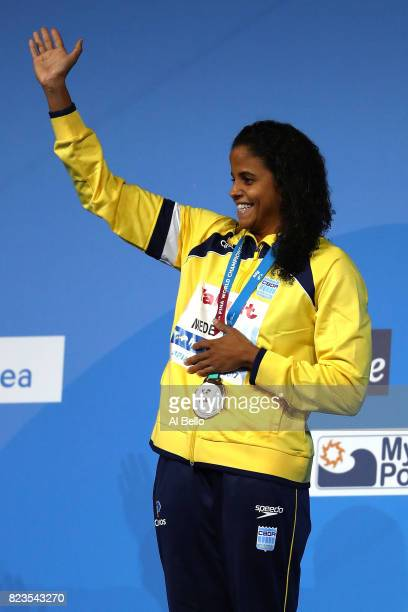 Gold medalist Etiene Medeiros of Brazil poses with the medal won during the Women's 50m Backstroke final on day fourteen of the Budapest 2017 FINA...