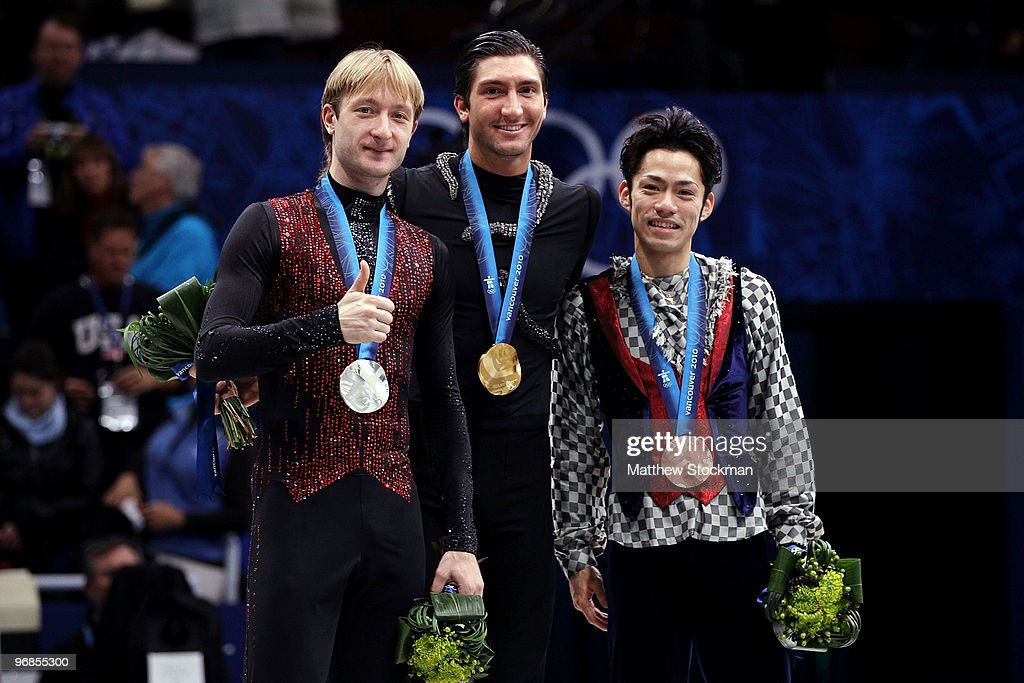 Gold medalist Evan Lysacek of the United States poses with silver medalist Evgeni Plushenko of Russia and bronze medalist Daisuke Takahashi of Japan...