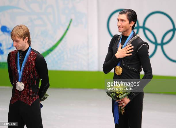 Gold medalist Evan Lysacek of the US and Rusiian silver medalist Evgeni Plushenko pose on the podium after the men's 2010 Winter Olympics figure...