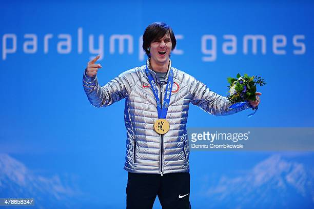 Gold medalist Evan Strong of the United States celebrates during the medal ceremony for Men's Snowboard Cross Standing on day seven of the Sochi 2014...