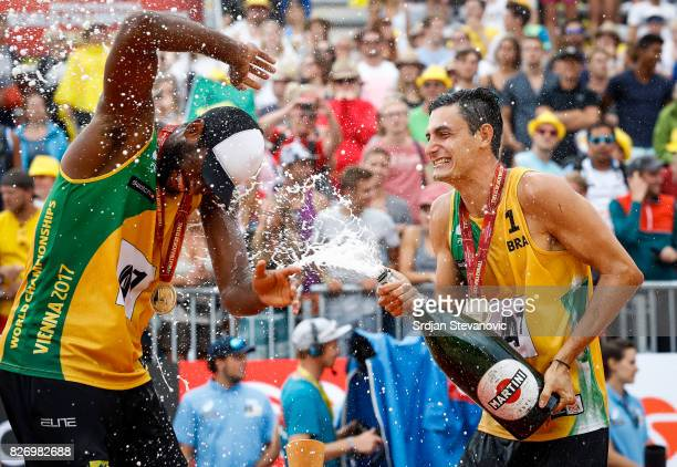 Gold medalist Evandro and Andre Loyola of Brazil celebrate during the medal ceremony for the Men's Final on August 06 2017 in Vienna Austria