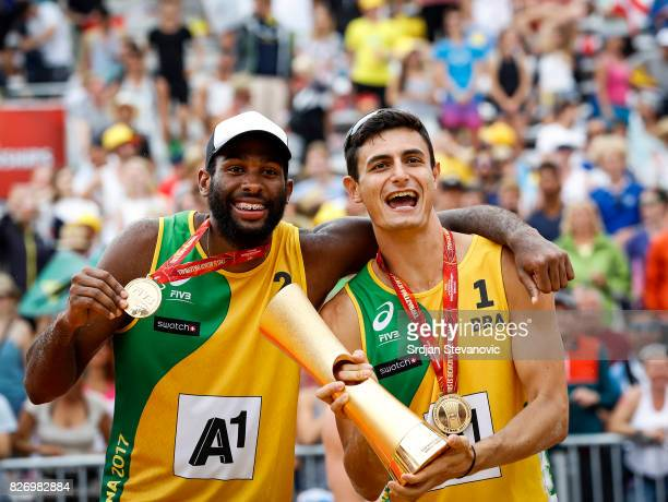 Gold medalist Evandro and Andre Loyola of Brazil pose for the photo during the medal ceremony for the Men's Final on August 06 2017 in Vienna Austria