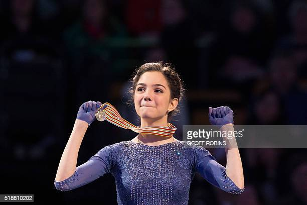 Gold medalist Evgenia Medvedeva of Russia celebrates during the victory ceremony for the Ladies competition at the ISU World Figure Skating...