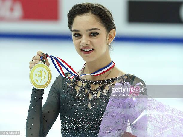 Gold medalist Evgenia Medvedeva of Russia poses during Senior Ladies medal ceremony on day three of the ISU Grand Prix of Figure Skating 2016 at...