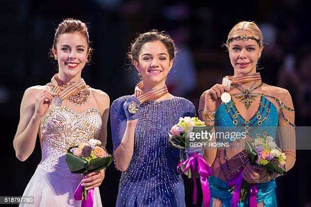 Gold medalist Evgenia Medvedeva of Russia poses for photographs with silver medalist Ashley Wagner of the United States and bronze medalist Anna...