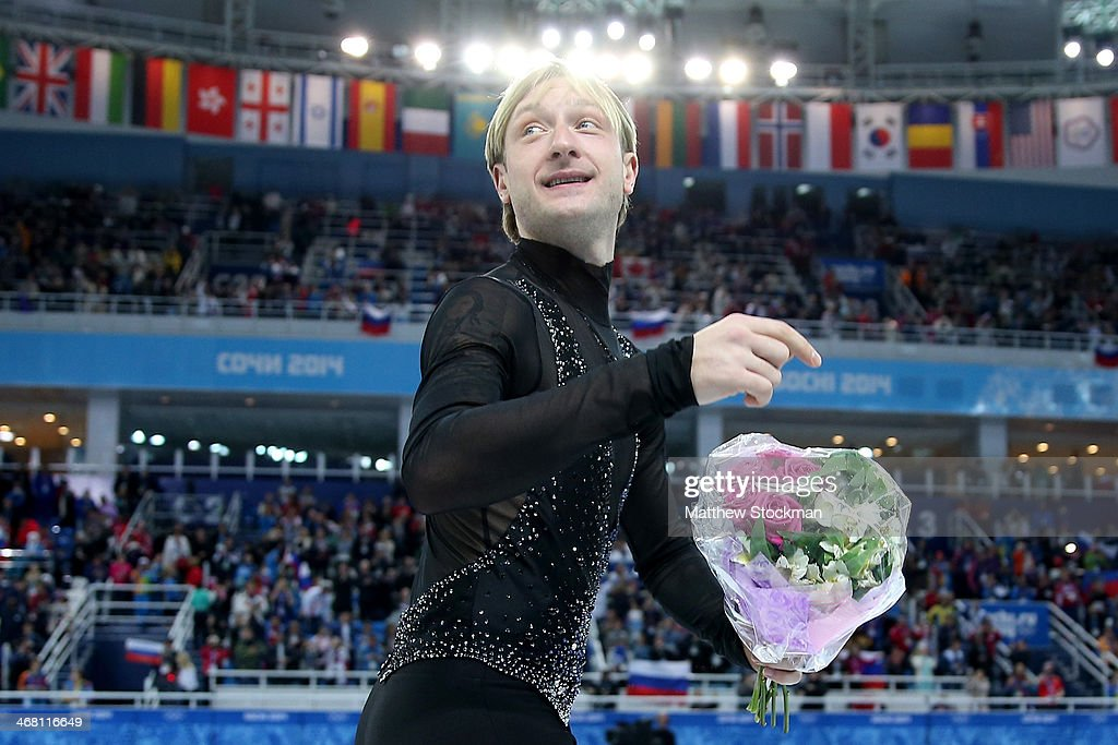 Gold Medalist Evgeny Plyushchenko of Russia skates with teammates after the flower ceremony for the Team Figure Skating Overall during day two of the Sochi 2014 Winter Olympics at Iceberg Skating Palace onon February 9, 2014 in Sochi, Russia.
