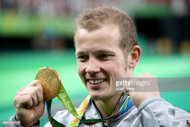 Gold medalist Fabian Hambuechen of Germany poses for photographs after the at the medal ceremony for the Horizontal Bar on Day 11 of the Rio 2016...