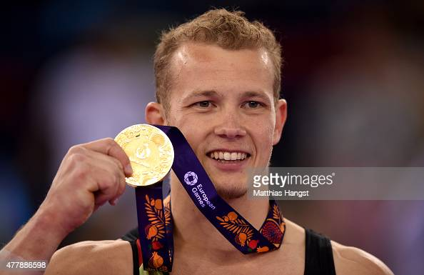Gold medalist Fabian Hambuechen of Germany poses with the medal won during the Men's Gymnastics Horizontal Bar final on day eight of the Baku 2015...
