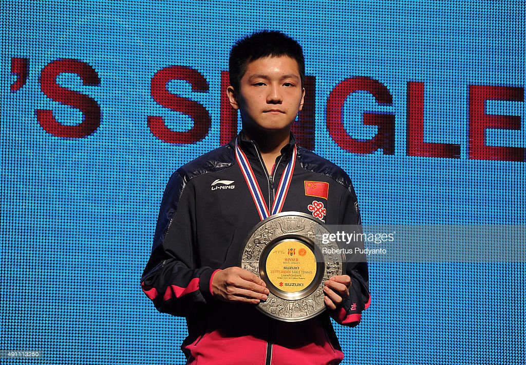 Gold medalist Fan Zhendong of China celebrates on the podium during Men's singles awarding ceremony of the 22nd 2015 ITTF Asian Table Tennis Championships at Pattaya Sports Indoor Stadium on October 3, 2015 in Pattaya, Thailand.