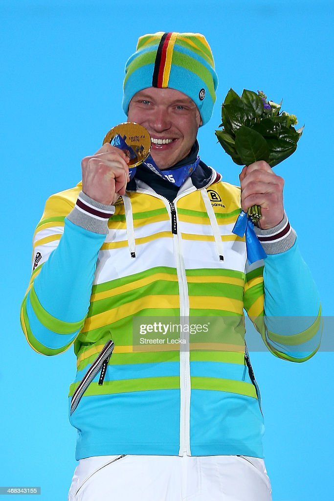 Gold medalist <a gi-track='captionPersonalityLinkClicked' href=/galleries/search?phrase=Felix+Loch&family=editorial&specificpeople=4840944 ng-click='$event.stopPropagation()'>Felix Loch</a> of Germany celebrates during the medal ceremony for the Men's Luge Singles on day 3 of the Sochi 2014 Winter Olympics at Medals Plaza in the Olympic Park on February 10, 2014 in Sochi, Russia.