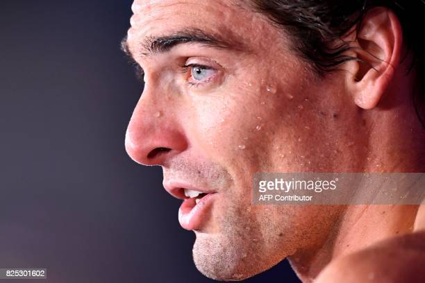 Gold medalist France's Camille Lacourt celebrates after winning the final of the men's 50m backstroke during the swimming competition at the 2017...