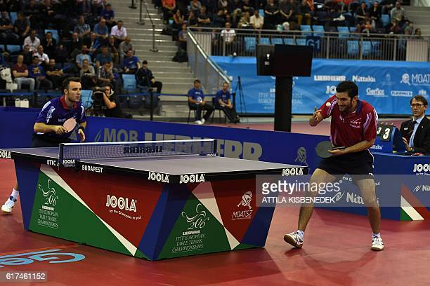 Gold medalist France's Emmanuel Lebesson serves to France's Simon Gauzy in 'Tuskecsarnok' sports hall of Budapest on October 23 2016 during the men...
