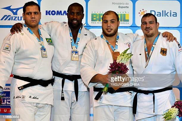 Gold medalist France's Teddy Riner Silver medalist Brazil's Rafael Silva Bronze medalists Germany's Andreas Toelzer and Tunisia's Faicel Jaballah...