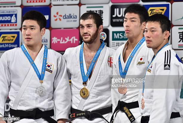 Gold medalist Georgia's Avtandili Tchrikishvili silver medalist South Korea's Lee Seungsu and bronze medalists Japan's Takanori Nagase South Korea's...