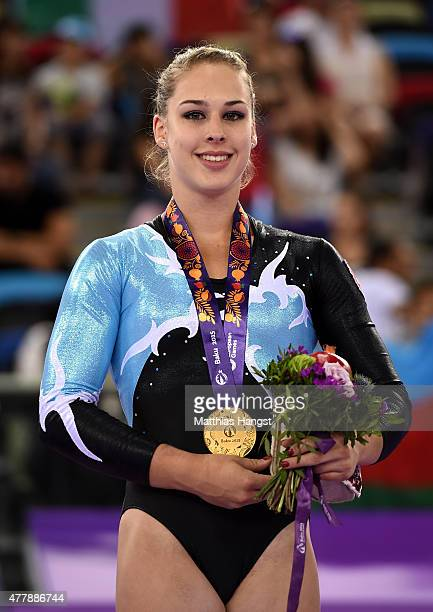 Gold medalist Giulia Steingruber of Switzerland poses on the medal podium for the Women's Artistic Gymnastics Individual Floor Final during day eight...