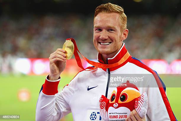 Gold medalist Greg Rutherford of Great Britain poses on the podium during the medal ceremony for the Men's Long Jump final during day five of the...