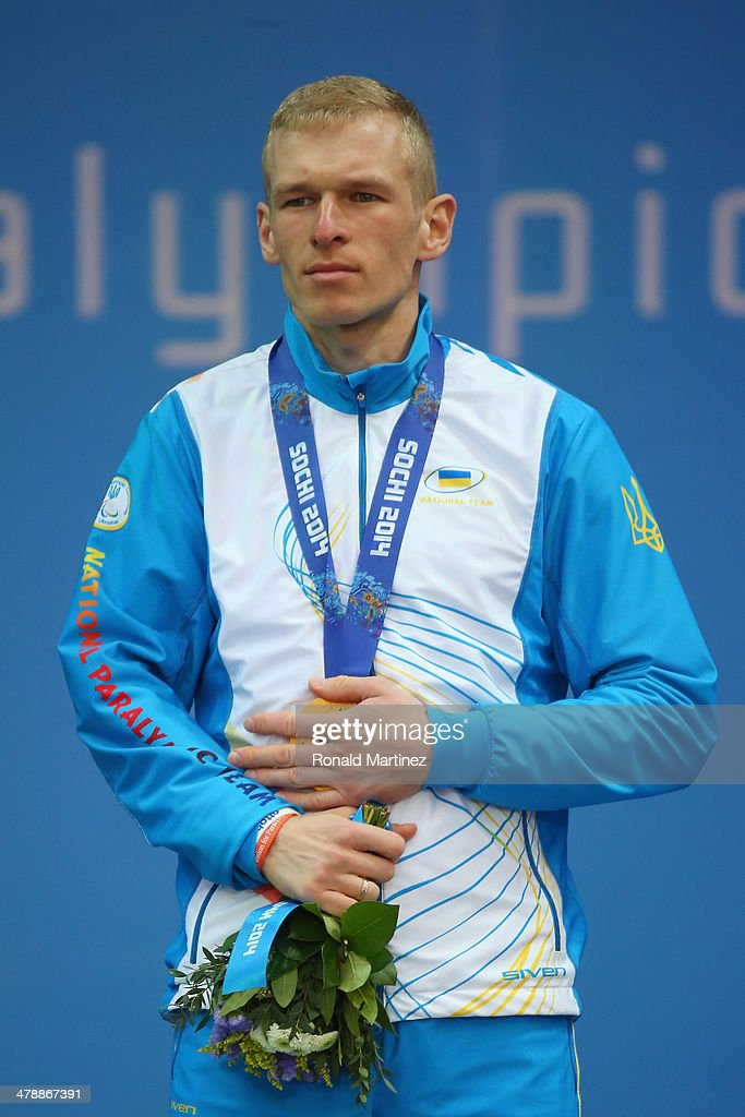 Gold medalist Grygorii Vovchynskyi of Ukraine covers his medal at the medal ceremony for the Men's 15km Standing Biathlon on day eight of the Sochi 2014 Paralympic Winter Games at Laura Cross-country Ski & Biathlon Center on March 15, 2014 in Sochi, Russia.