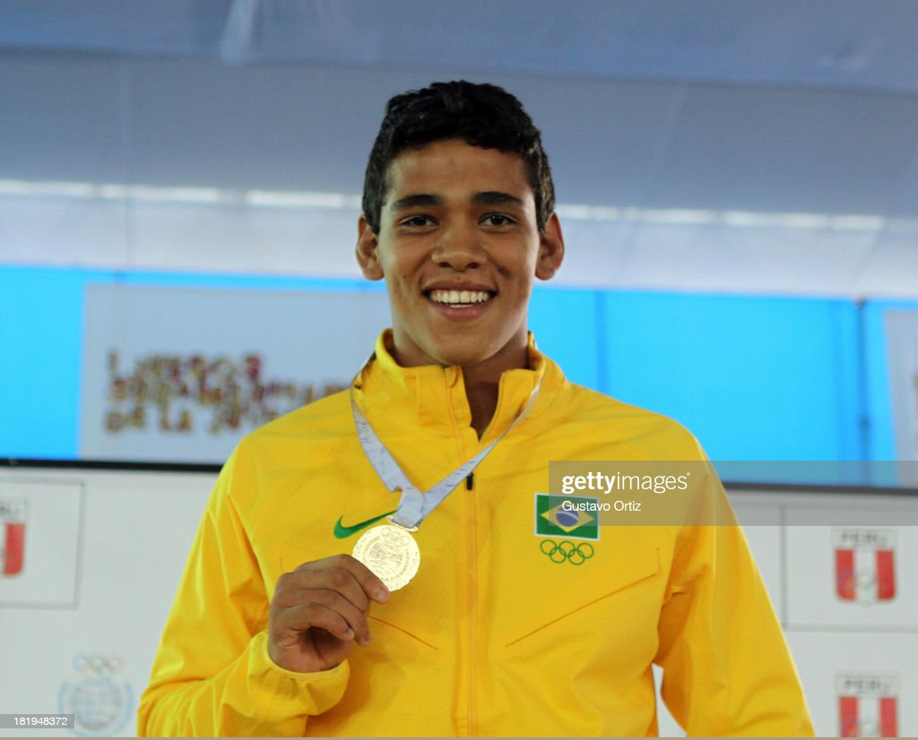 Gold medalist Guilherme Evangelista of Brazil in the podium of Greco Roman 85kg as part of the I ODESUR South American Youth Games at Polideportivo Villa Deportiva del Callao on September 26, 2013 in Lima, Peru.