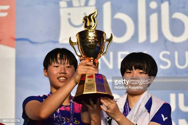 Gold medalist Ha Na Baek and Lee Yu Rim of Korea celebrate on the podium after beating Jauza Fadhila Sugiarto and Ribka Sugiarto of Indonesia in the...